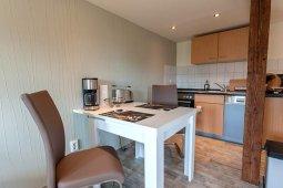 Küche mit Sitzgelegenheit im Ferienhaus